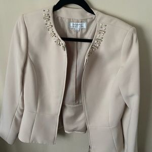 Nude blazer with pearls detailing.